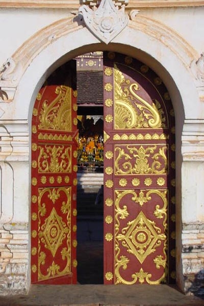 Send picture of Doors of a Lao Buddhist temple from Laos as a free postcard