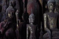 Picture of Lao statues of Buddha in a cave on the Mekong River - Laos