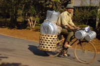 Picture of Man on bike in Laos - Laos