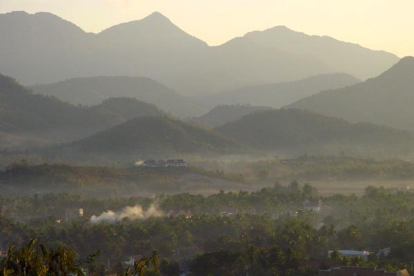 Send picture of View over mountains in Laos from Laos as a free postcard