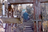 Picture of Man praying at the Hill of Crosses - Lithuania
