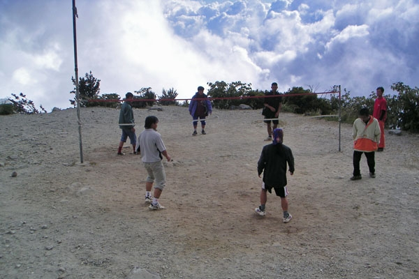 Send picture of Men playing volleyball on Mount Kinabalu from Malaysia as a free postcard