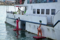 Picture of Men cleaning a ship in Kota Kinabalu - Malaysia