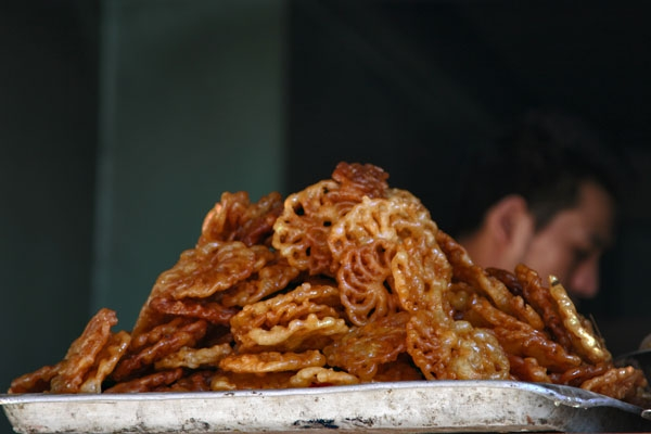Send picture of Snacks in a street kitchen in Kathmandu from Nepal as a free postcard