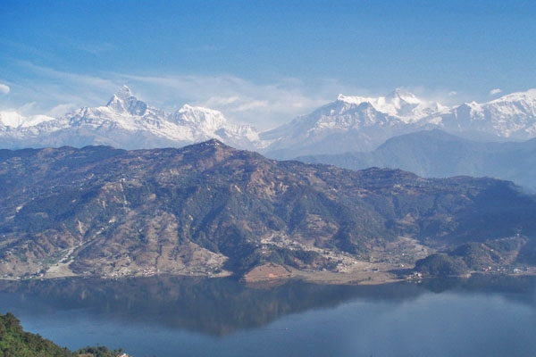 Send picture of Fewa Lake and mountains from Nepal as a free postcard