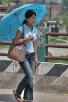 Picture of Woman with blue parasol walking in Kathmandu - Nepal
