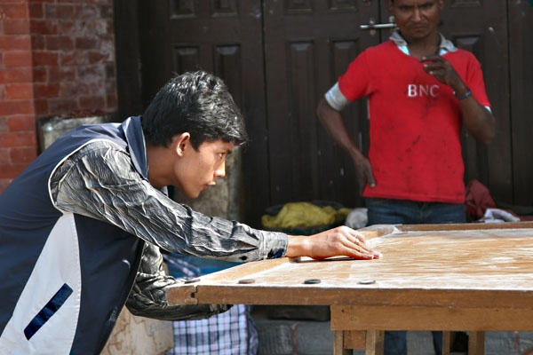 Send picture of Young people playing a board game in Kathmandu from Nepal as a free postcard