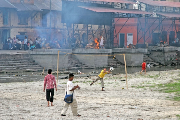 Send picture of People playing volleyball by the Pashupatinath cremation place from Nepal as a free postcard