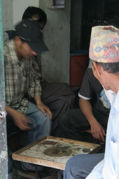 Send picture of Men spending time playing board games from Nepal as a free postcard