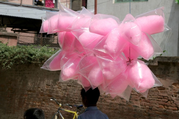 Send picture of Boy selling candyfloss in Kathmandu from Nepal as a free postcard