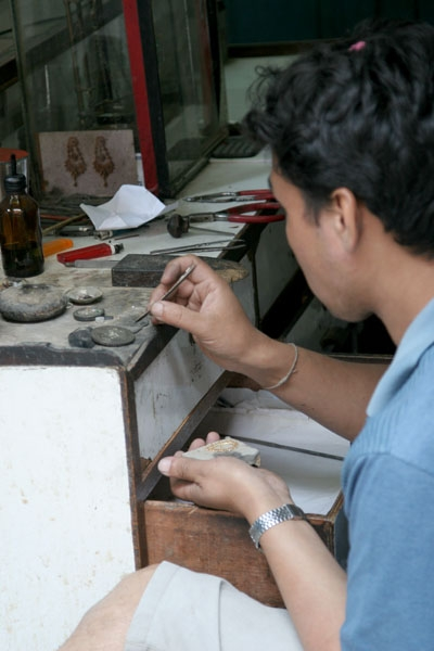Send picture of Man making jewellery from Nepal as a free postcard