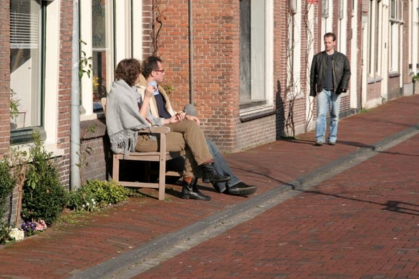 Send picture of People enjoying the sun outside their Leiden home from Netherlands as a free postcard