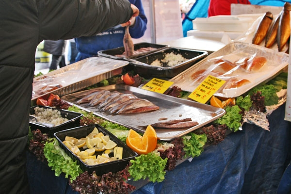 Send picture of Raw herring at the fish market in Leiden from Netherlands as a free postcard