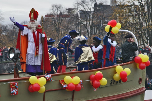 Send picture of Sinterklaas waving from his boat from Netherlands as a free postcard