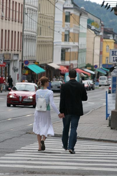 Send picture of Couple walking the streets of Oslo from Norway as a free postcard