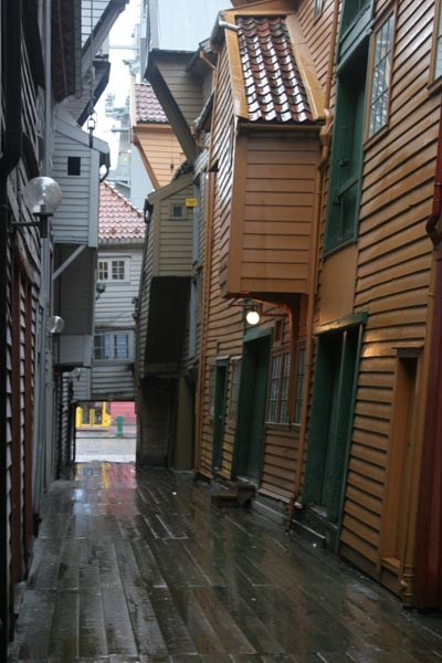 Send picture of Typical wooden houses on a rainy day in Bergen from Norway as a free postcard