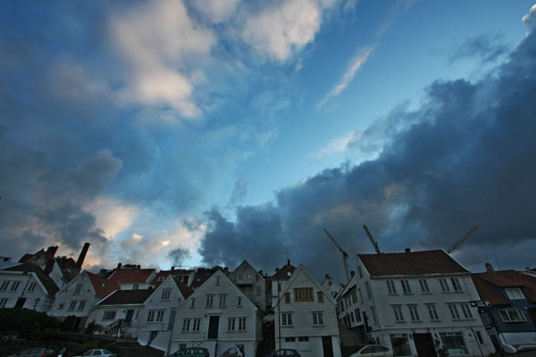 Send picture of Houses in Stavanger and a Nordic evening sky from Norway as a free postcard