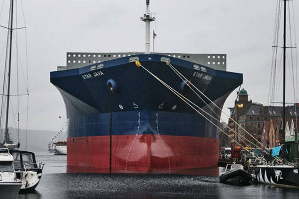 Send picture of Gigantic ship in Bergen harbor from Norway as a free postcard