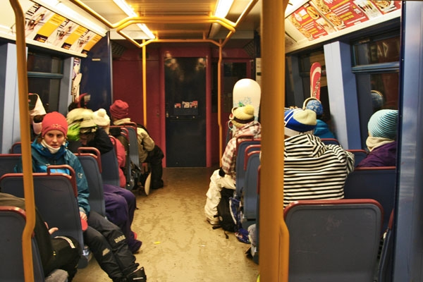 Send picture of People on the train going back from skiing from Norway as a free postcard