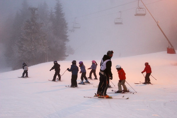 Send picture of Children skiing at Tryvann Vinterpark from Norway as a free postcard