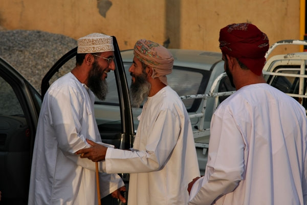 Send picture of Omani men greeting at an Eid celebration in Misfat from Oman as a free postcard