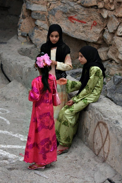 Send picture of Young Omani women at the entrance of Misfat from Oman as a free postcard