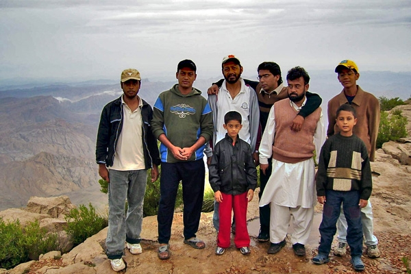 Send picture of Pakistani tour group with Balochistan in the background from Pakistan as a free postcard