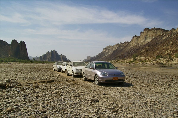 Send picture of Convoy of cars in Hungol Valley from Pakistan as a free postcard