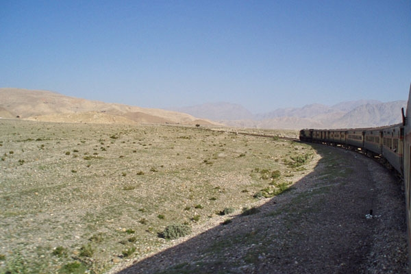 Send picture of Train moving through the Pakistani landscape from Pakistan as a free postcard