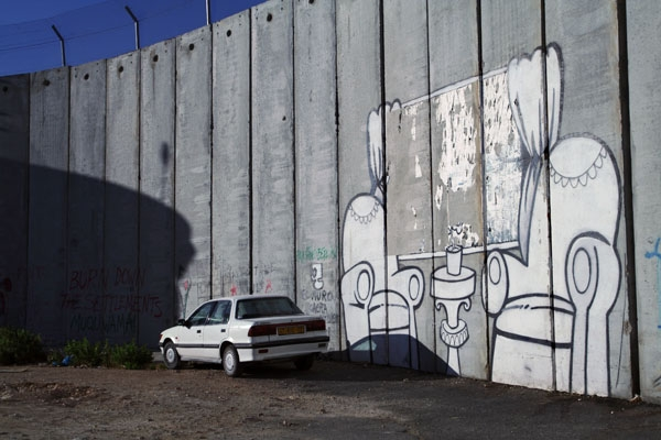  Painting and car by the separation wall in Bethlehem