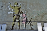 Photo de Stencil by Banksy near the separation wall in Bethlehem - Palestinian Territories