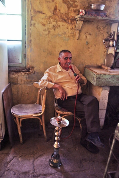 Send picture of Man smoking shisha in a café in Nablus from Palestinian Territories as a free postcard