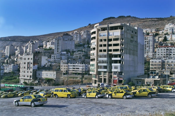 Send picture of Parking area for taxis in Nablus from Palestinian Territories as a free postcard