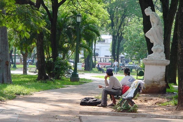Send picture of People sitting in a park in Asuncin from Paraguay as a free postcard