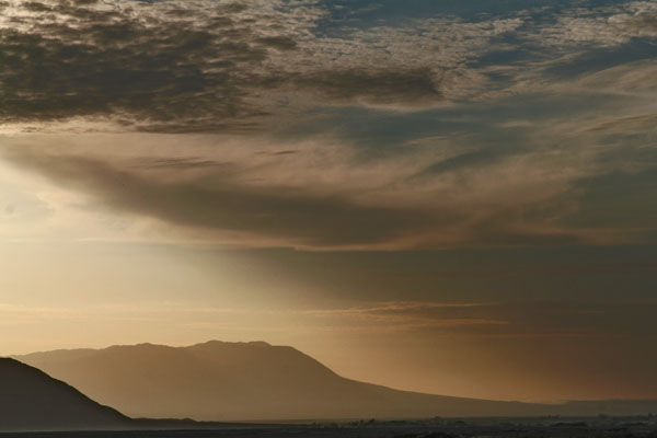 Send picture of Early evening light near Nazca from Peru as a free postcard