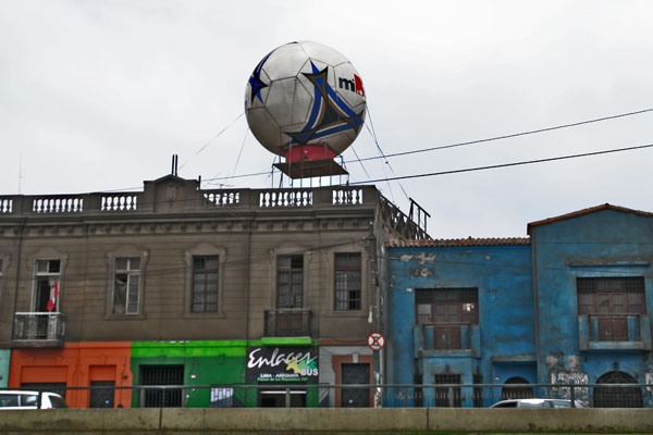 Send picture of Football figure close to the stadium in Lima from Peru as a free postcard
