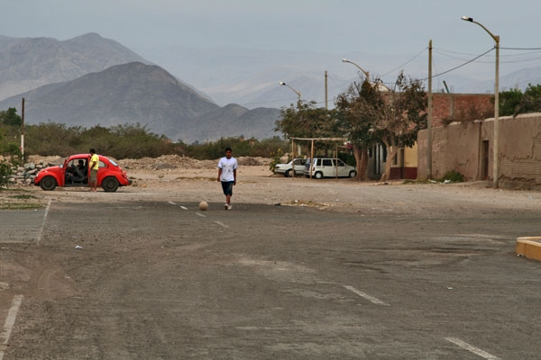 Send picture of Young man playing football in Nazca from Peru as a free postcard