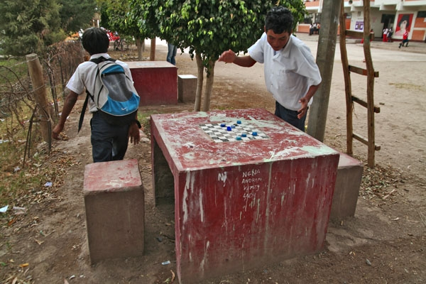 Send picture of Checkers table in a  Nazca school yard from Peru as a free postcard