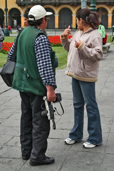 Send picture of Photographer working at Plaza de Armas in LIma from Peru as a free postcard