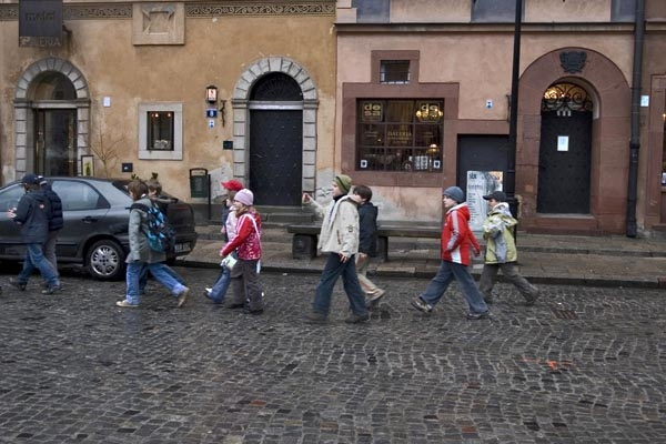 Send picture of Young students on the way home from school in Warsaw from Poland as a free postcard