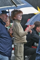 Foto di Boy watching a sports event in Warsaw - Poland