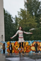 Foto van Girl doing a dance performance in the Praga neighborhood of Warsaw - Poland