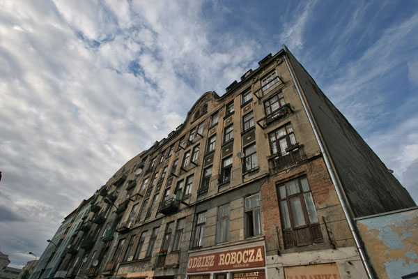 Send picture of Apartment building in the Praga neighborhood in Warsaw from Poland as a free postcard