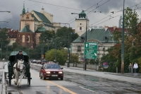 Picture of Car and horse drawn carriage in Warsaw - Poland
