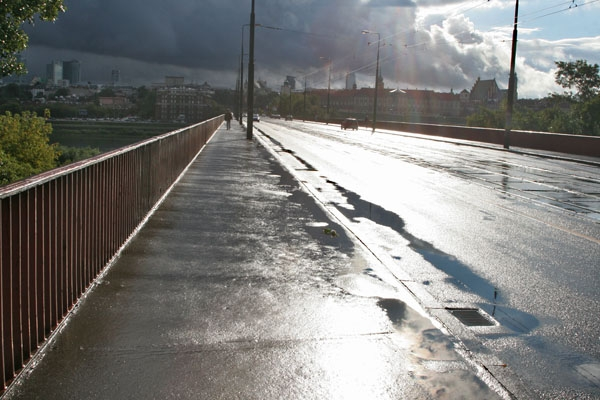 Send picture of Sun on a wet road in Warsaw from Poland as a free postcard