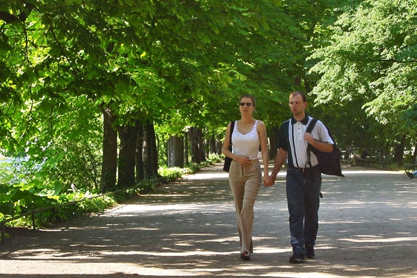 Send picture of Couple walking in a park in Warsaw on a Summer day from Poland as a free postcard
