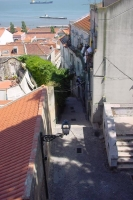 Foto van Small street leading to the river Tejo - Portugal
