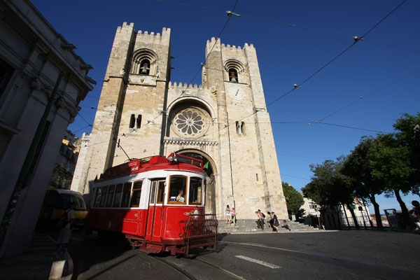 Send picture of Tram and Sé cathedral in Lisbon from Portugal as a free postcard