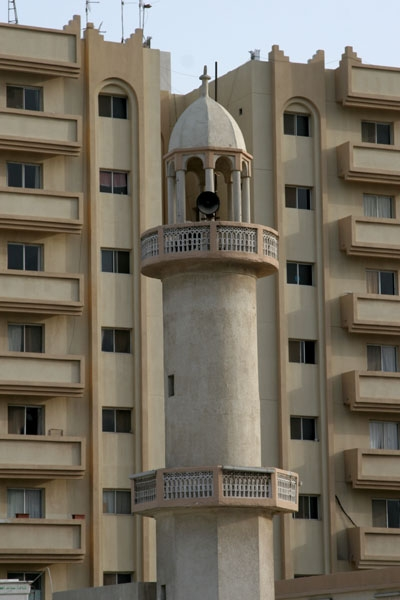 Send picture of Minaret and apartment buildings in Doha from Qatar as a free postcard