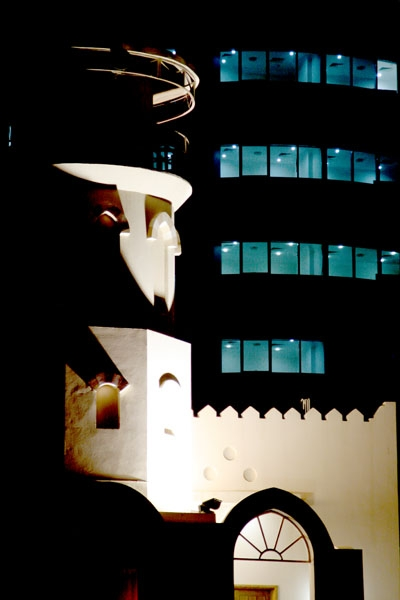 Send picture of Mosque and modern building at night time from Qatar as a free postcard